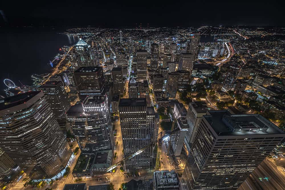 Aerial view of Seattle at night showing light pollution