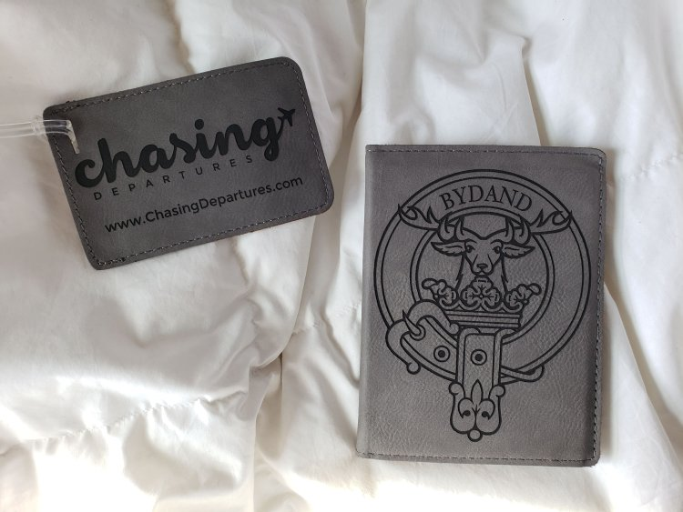 Custom Chasing Departures logo luggage tag and Bydand Gordon family crest passport cover
