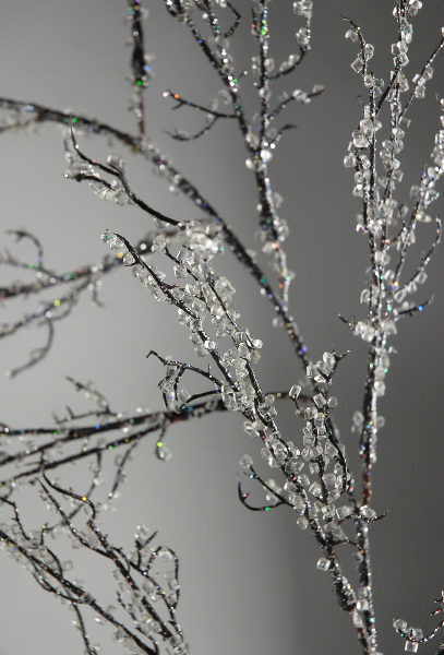 Diamond vase filler and glass glitter glued to branches to make iced branches.
