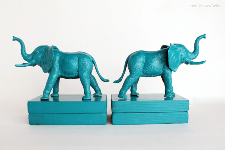Two turquoise elephant animal bookends.