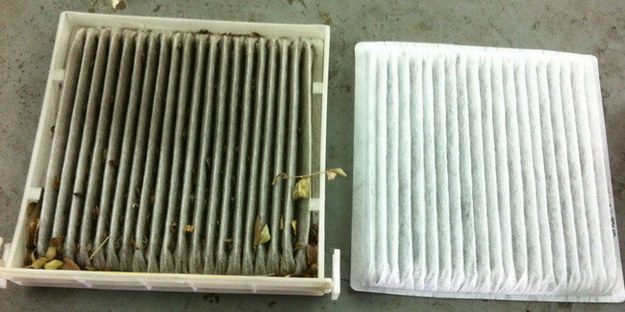 A dirty air filter side by side with a clean air filter