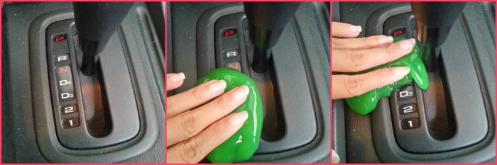 Green slime being used to clean a car's gear stick.