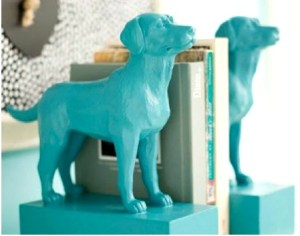 Two turquoise labrador animal bookends.