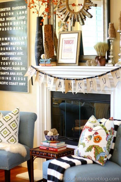 "A bunting hanging across a fireplace spelling out the word ""Thankful""."