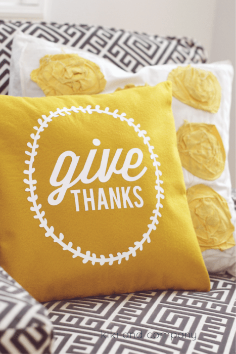 "A yellow DIY pillow with the words ""give THANKS"" written on it."