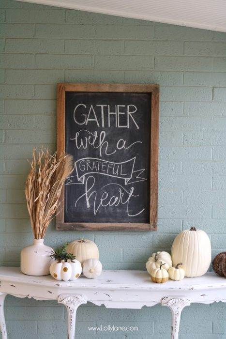 "A chalkboard hung to the wall with the words ""GATHER with a GRATEFUL heart"" written on it."