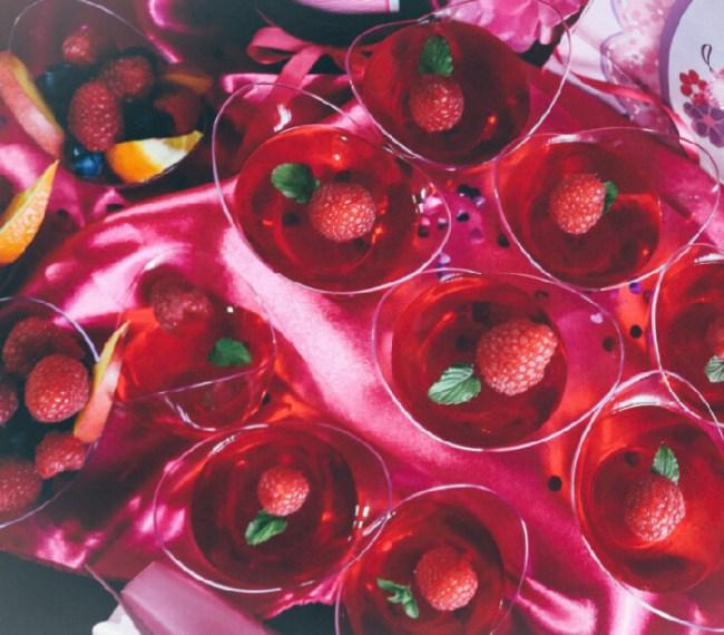 Small tubs of raspberry jello