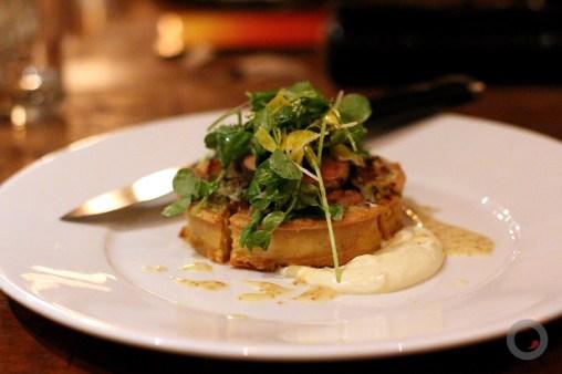 Foie gras and Smoked Pork belly tart smoked gruyere, tomato, fine herbs, greens, champagne cider vinaigrette
