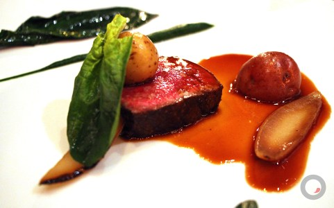 Prime Strip of Beef, alliums, spinach cooked in beef fat, smoked potato, pickled onions, foie gras butter.