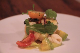 Insalata di mare with sepia, octopus, shrimp, arugula, avocado, saffron mussel vinaigrette