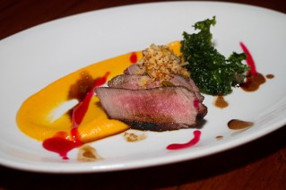 Boneless Aussie lamb loin with cranberry mustard, pistachio, crispy kale and aju amarillo pumpkin puree