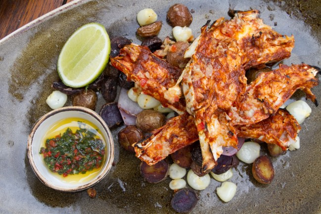 King Crab Plancha Anticuchera – crushed potatoes, ají panca pepper sauce, chimichurri, choclo corn