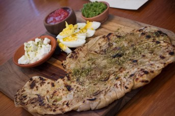 Malawach with yemenite bread, harriff, feta, hardboiled egg