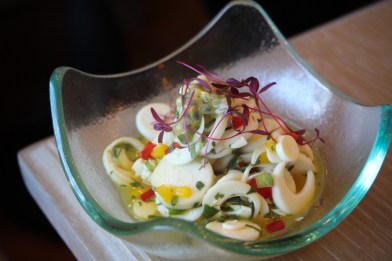 Hearts of Palm Ceviche that features thinly sliced hearts of palm tossed with passion fruit, cilantro and bell pepper
