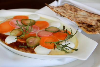 Shakshouka with its version filled with rabbit merguenz, lebni and served with a fermented potato flatbread