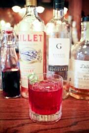 Four Rosés featuring rosé wine, Lillet rosé, Dillon's gin-based rosé liqueur, rosebud and hibiscus flower water and a lemon twist