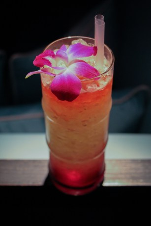 Pisco Punch created with Kappa Pisco, Lillet Rosé, hibiscus syrup, pineapple juice, lime juice and fresh herbs.