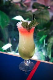 Melolo Swizzle made with Martinique coconut rum, midori, banane du Bresil, pineapple and fresh basil