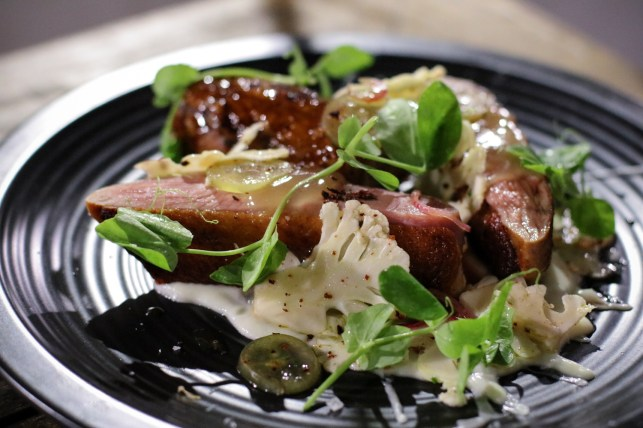 Duck a la Grape with duck magret, white grape shiro teriyaki, cauliflower, aleppo pepper, saba, red grape and duck jus.