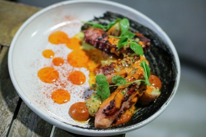 Octopus w/ Black Romesco, Nduja, Watercress, Desiree Potatoes, Almonds & Piquillo Pil Pil
