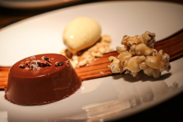 Chocolate Cremeux with candied popcorn, pretzel crumble, cocoa nibs and malted milk ice cream