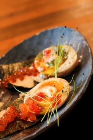 Deviled Egg with Hanjuku egg, Ikura, pea tendrils, sesame wind