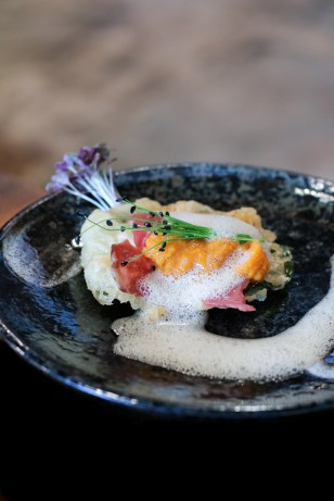 Uni Taco with tempura nasturitum, uni, wagyu, shisho air