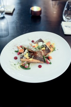Sunburst Farms Trout with saffron braised endive, spring vegetables, beet confit and smoked trout roe