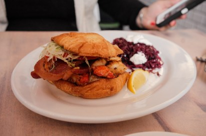 Lobster BLT - An entire Maine lobster chunked and served Key West style, with Miami Smokers bacon, lettuce, tomato and our homemade spicy mayonnaise, served on a croissant.