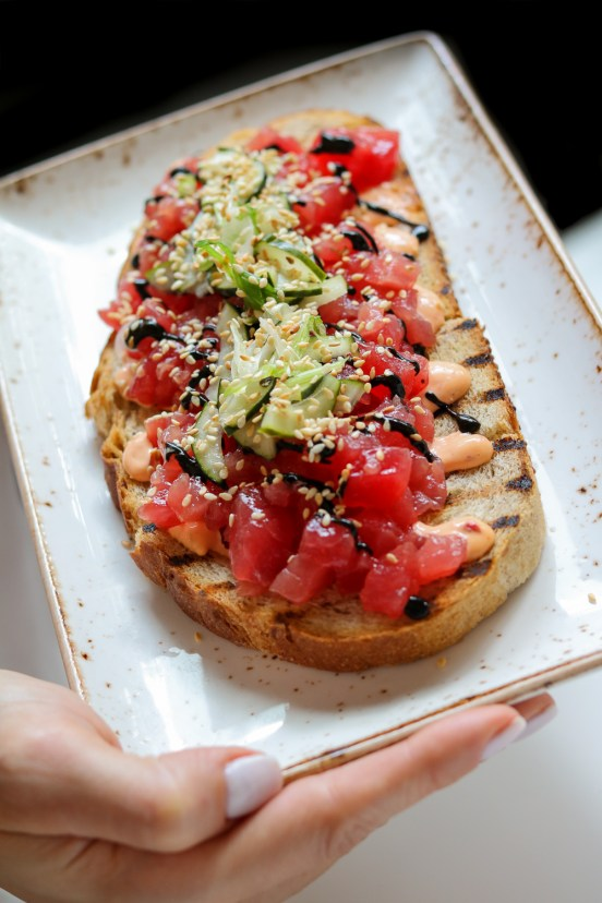 Spicy Tuna Toast w/ Pickled Cucumbers, Scallions & Grilled Nori Puree