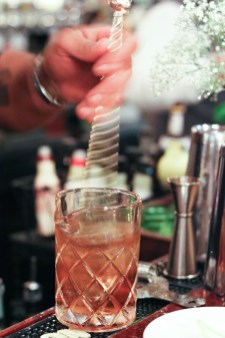 Chicago Overcoat made with Jim Beam® Black, Cocchi Americano, Laird's Applejack, Sage, Angostura and Cardamom Bitters