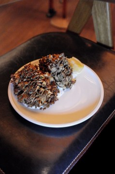 Whole Crispy Hen of the Woods Mushroom served with cloumage and herbs