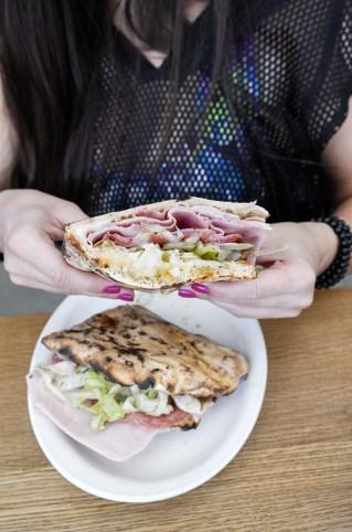 Italian Sandwich, stacked with prosciutto cotto, San Daniele prosciutto, sopresata, and iceberg