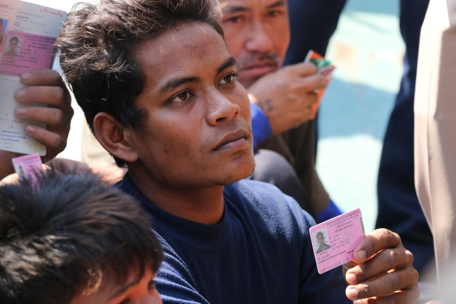 refugees showing their ids