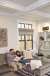 father and daughter reading book in living room | Chattanooga Home Inspector | carbon monoxide Chattanooga