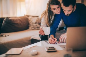 a couple working on papers | Chattanooga Home Inspector | buy a home Chattanooga