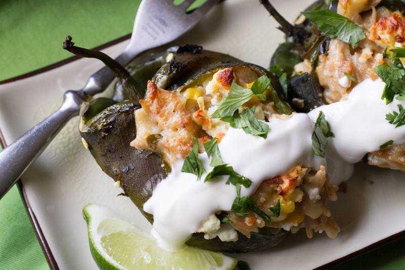 Stuffed poblanos with corn and orzo are infinitely more interesting than your standard stuffed peppers. They're easy to make to top it all off! | recipe from Chattavore.com