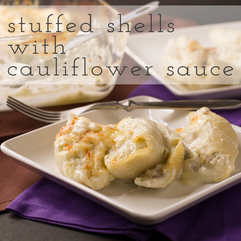 These mushroom and ricotta stuffed shells are topped with a creamy cauliflower sauce that tastes like a rich Alfredo. They're a decadent and delicious pasta dinner!