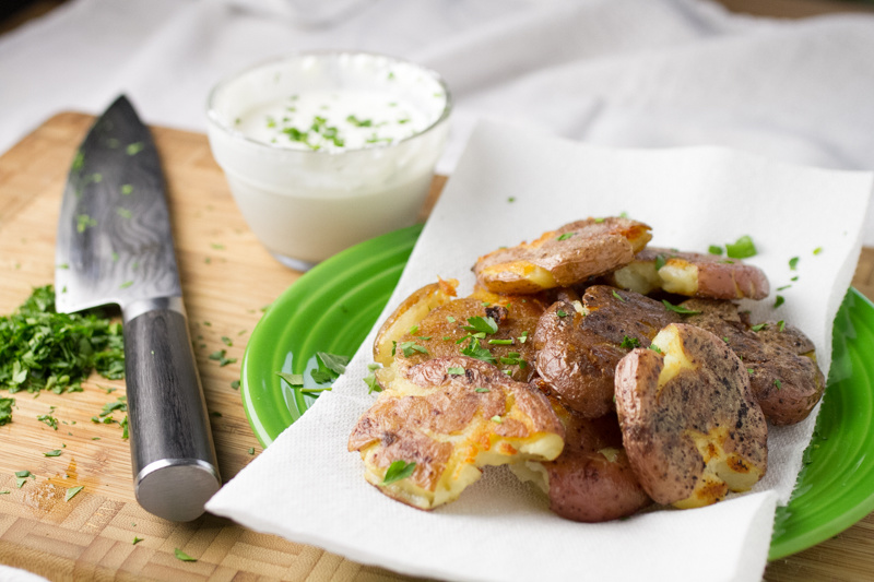Is there anything better than a crispy potato? I don't think so. These oven-roasted, crispy smashed red potatoes will make you smile!   recipe from chattavore.com