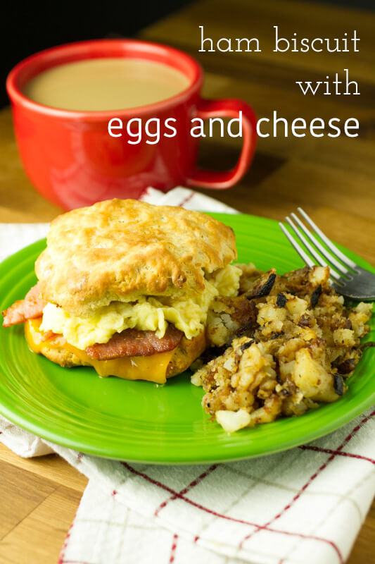 How can you go wrong with a giant ham biscuit? Country ham, scrambled eggs, and cheddar cheese make an out of this world breakfast sandwich! | recipe from Chattavore.com