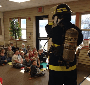 Firefighter talking to class