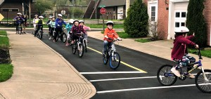 Students riding bicycles for Traffic & Bike Safety Course