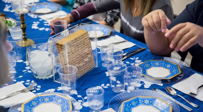 People sitting at a seder table