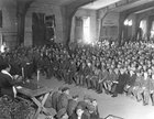 Rabbi Schacter of the U.S. Third Army delivers a religious service after the liberation of Buchenwald Concentration Camp