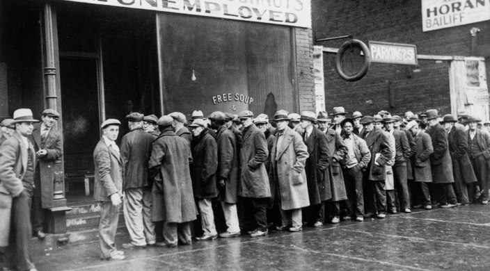 Unemployed men queued outside a Depression era soup kitchen opened in Chicago by mobster Al Capone in 1931