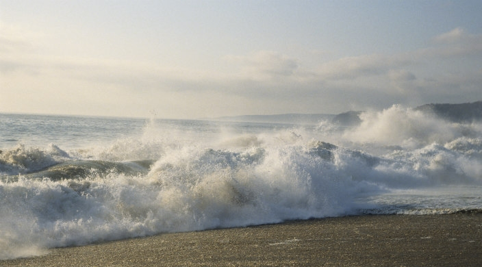 White-foamed waves crashing on the beach