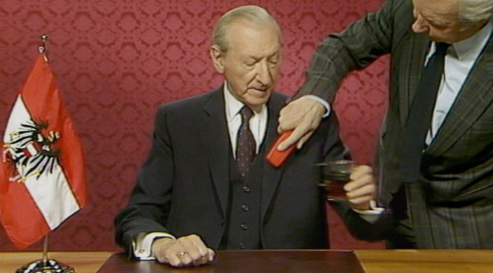 Still from the film featuring Waldheim appearing on Austrian national TV
