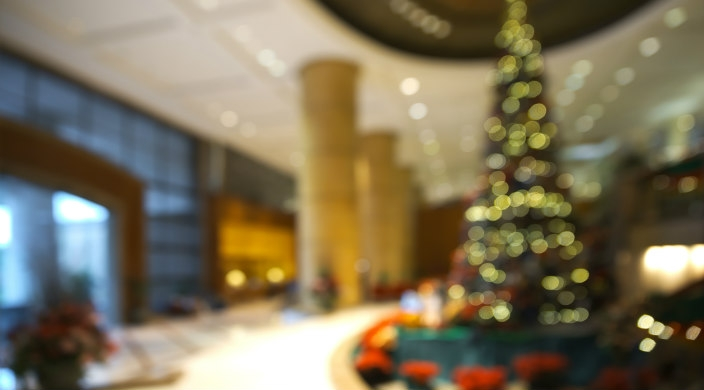 Blurry Christmas tree in the lobby of a building like a workplace or hotel