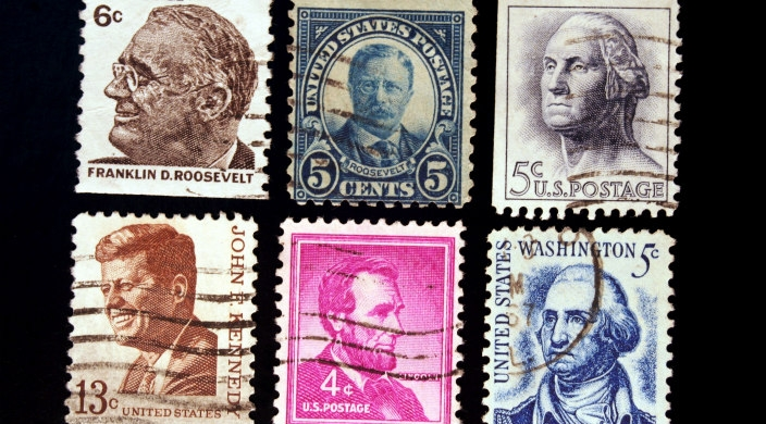 Six postage stamps honoring five U.S. presidents: FDR, Teddy Roosevelt, Washington, JFK, Lincoln, and Washington