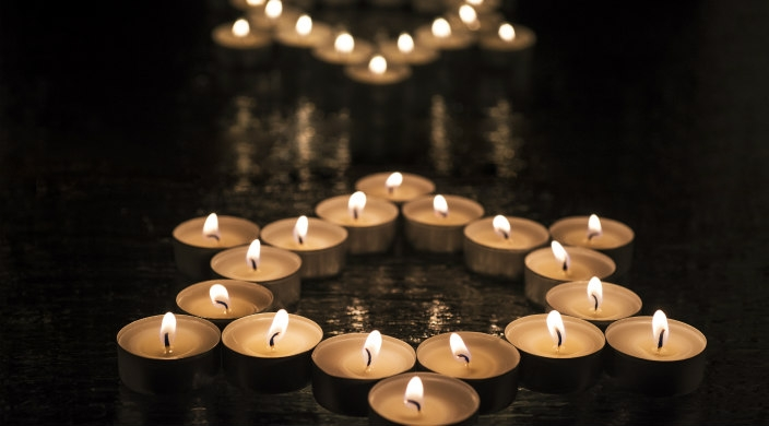 Lit tealights in the shape of a Star of David